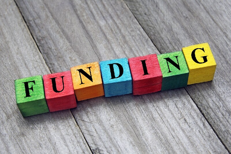 "The word ""funding"" is spelled out in colorful block letters."