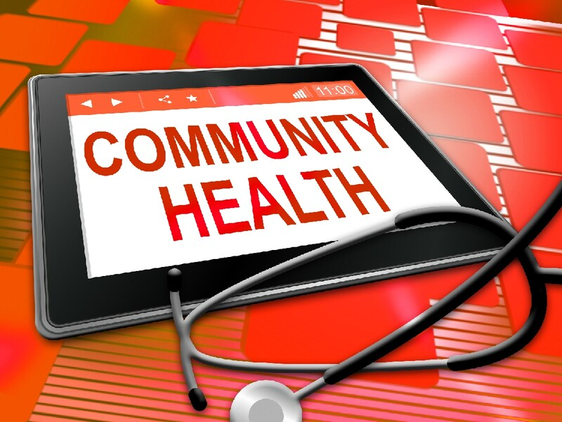 """Community Health"" appears on screen of an electronic device with a stethoscope in the foreground"