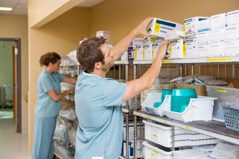 Two nurses arranging shelves of medical supplies